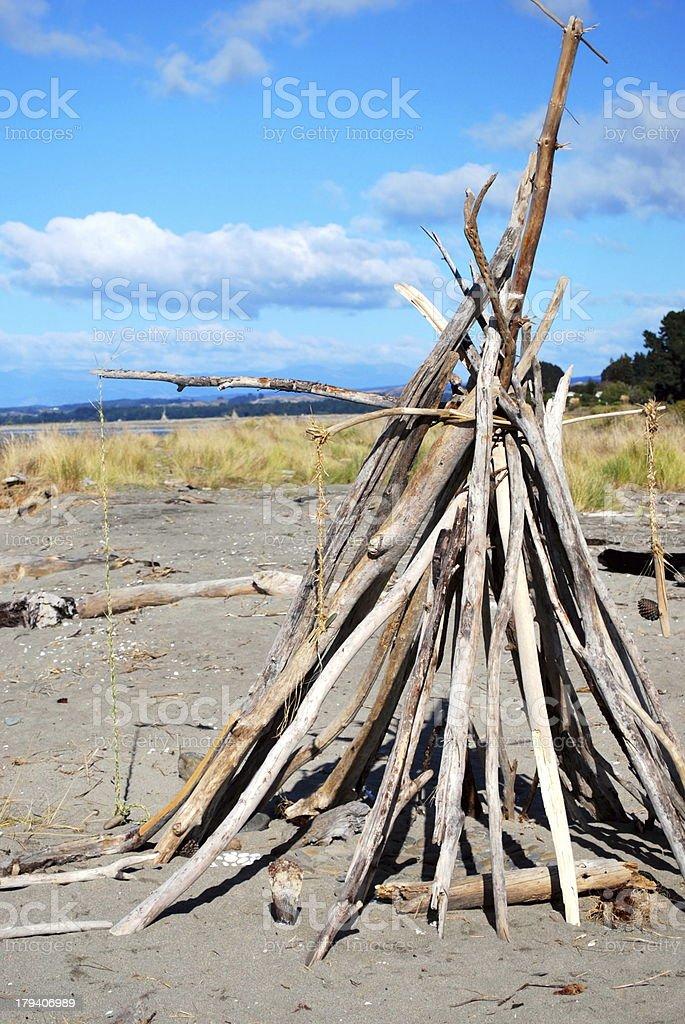 Driftwood Cairn, Motueka Spit, Tasman, New Zealand royalty-free stock photo