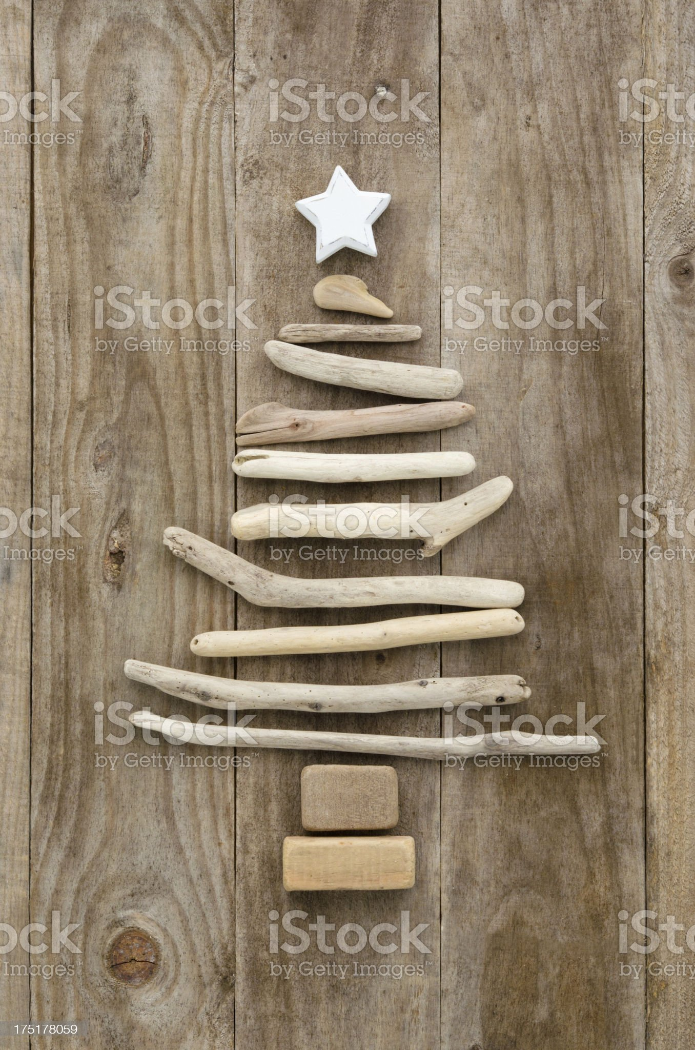 Driftwood Christmas tree on a rustic wood background. royalty-free stock photo