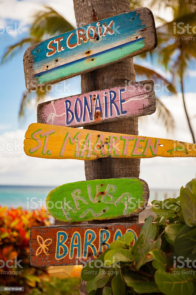 drifwoods with hand painted names of Caribbean islands stock photo