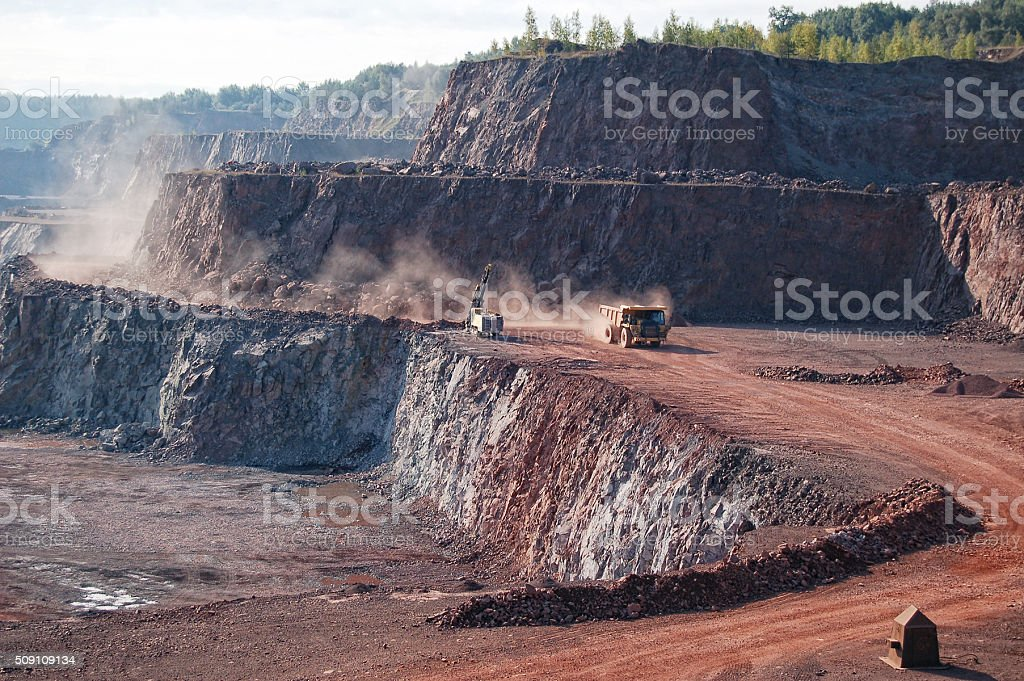 drill and dumper truck in a quarry mine. stock photo