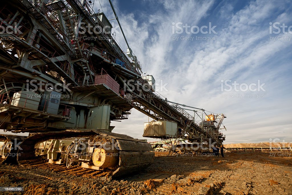 A drill machine does heavy mining in the desert stock photo