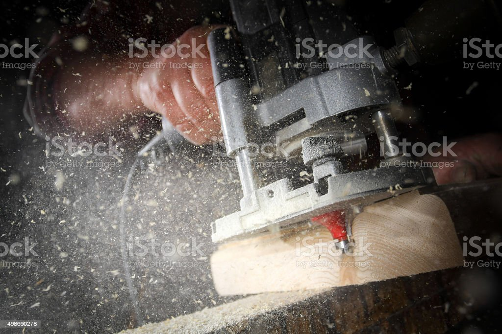 drill machine drilling a wood board stock photo
