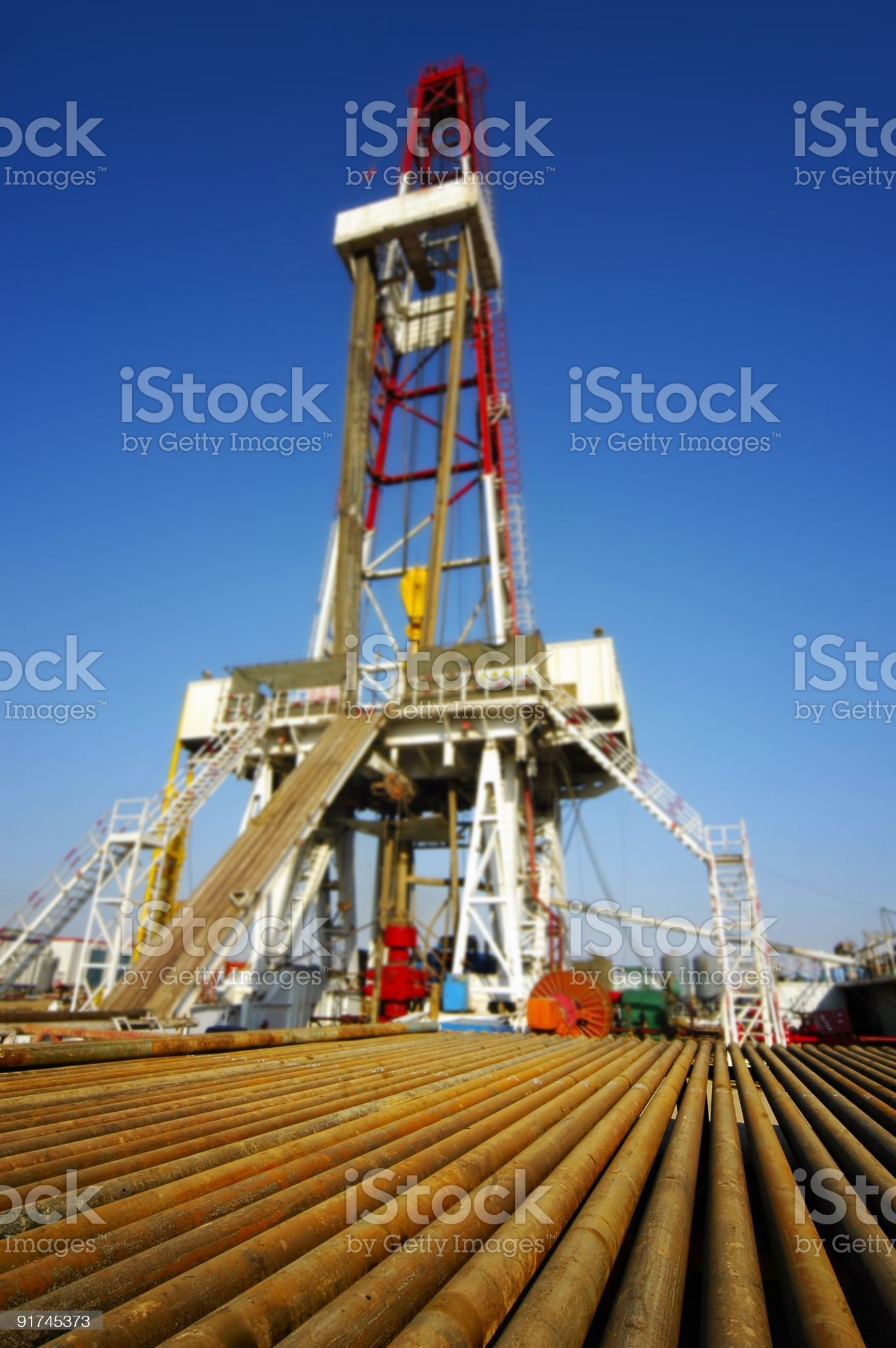 Drill pipe with drilling rig royalty-free stock photo