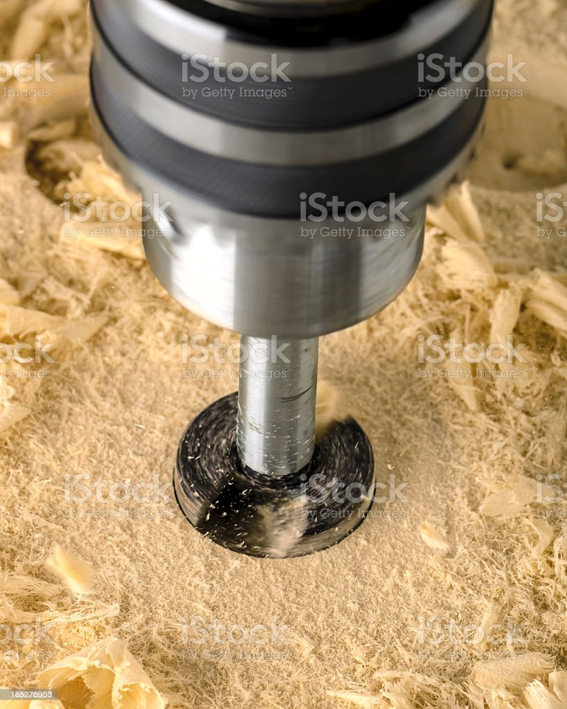 Drill Press and Forstner Bit Boring Into Wood stock photo