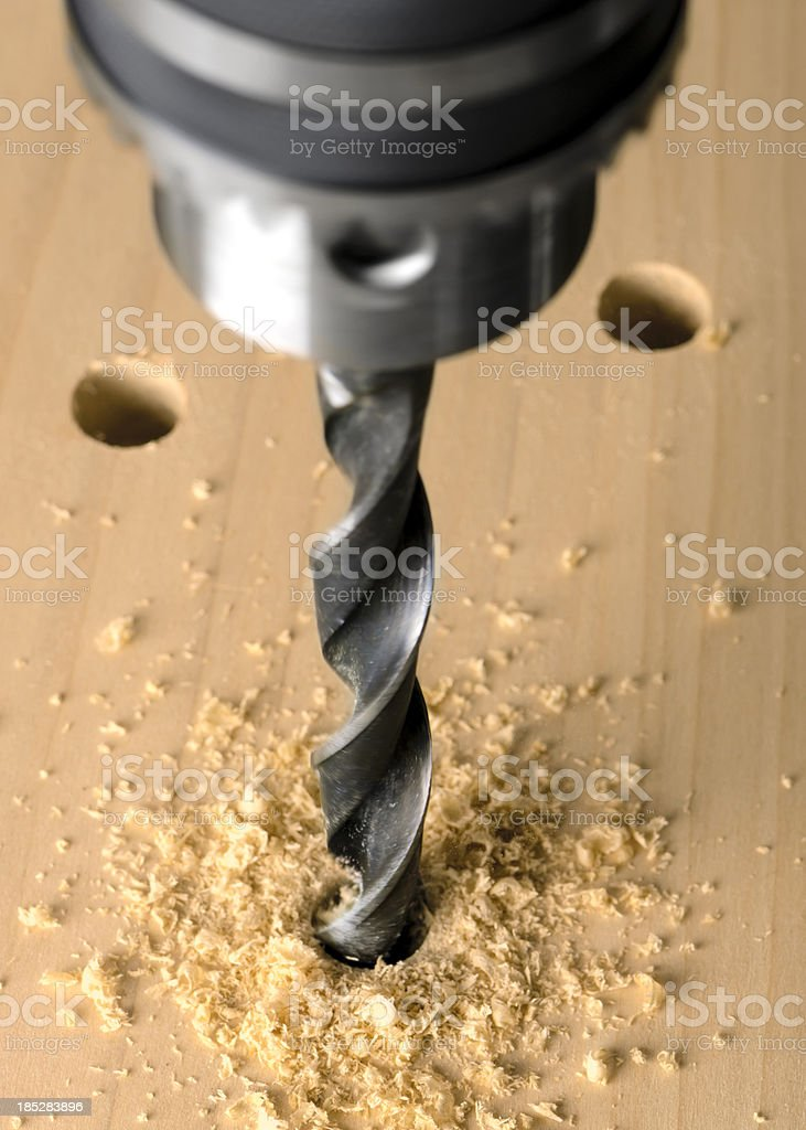 Drill Press and Twist Bit Boring Into Wood stock photo