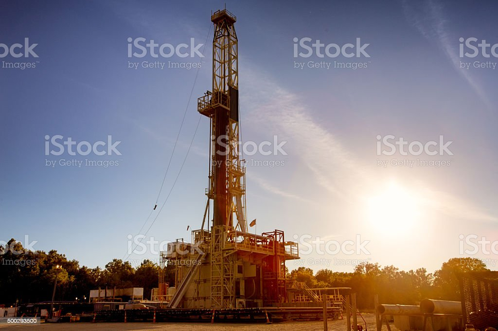 Drill Rig Fracking Operaton Silhouette at Dusk stock photo