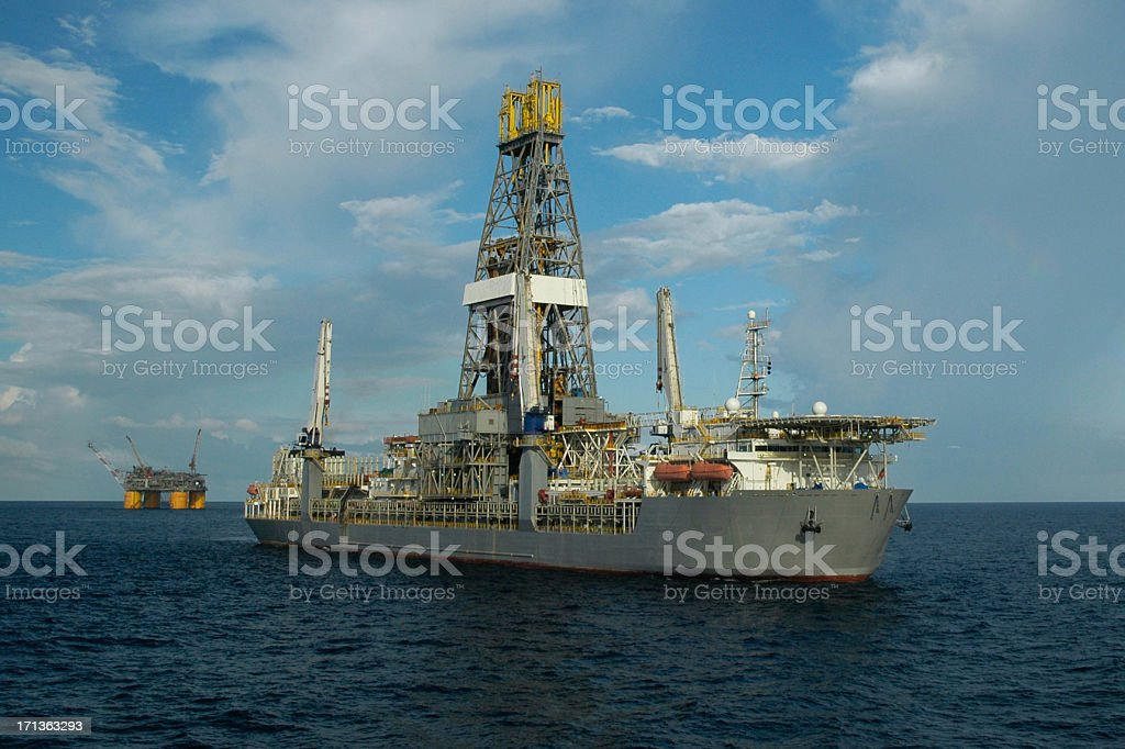 Drill ship and offshore production platform stock photo