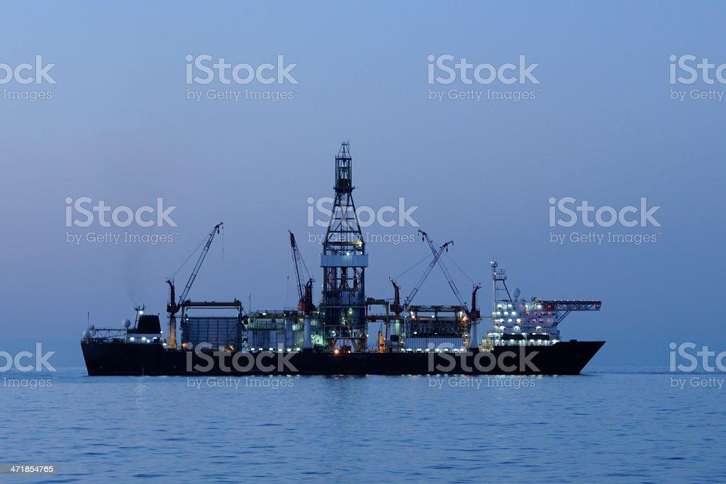 Drill ship before dawn stock photo