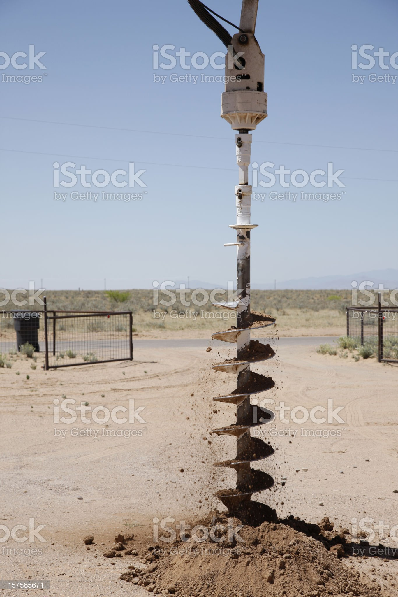 Drilling a Hole for Utility Pole with an Auger royalty-free stock photo