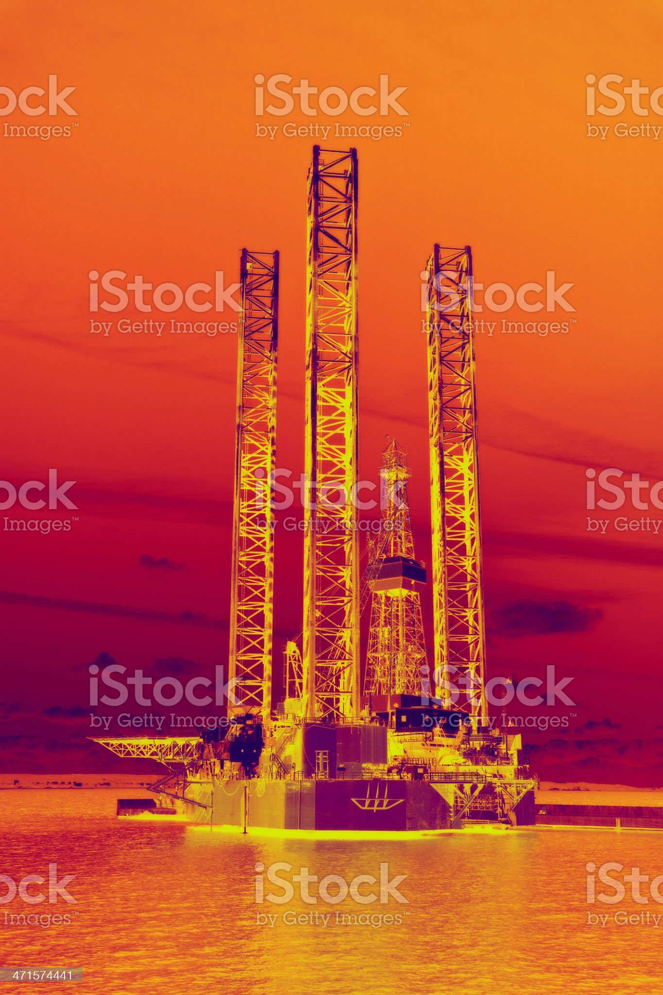 Drilling for Oil at Sunset royalty-free stock photo