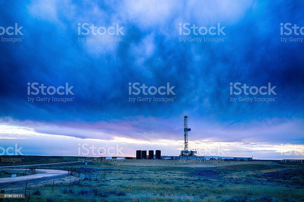 Drilling Fracking Rig at Dusk stock photo