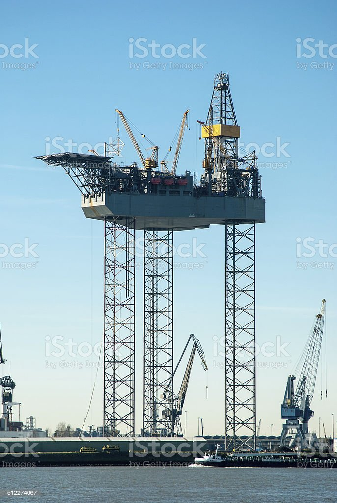 Drilling Jack jacked up in the harbor stock photo
