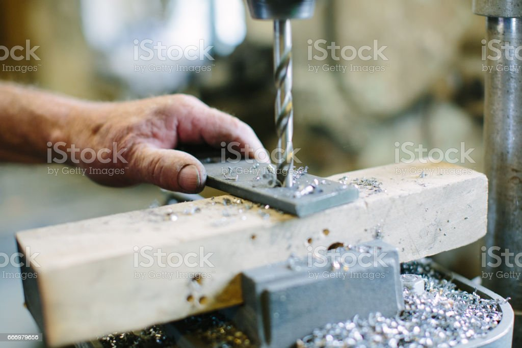 Drilling machine working on flat steel plate stock photo