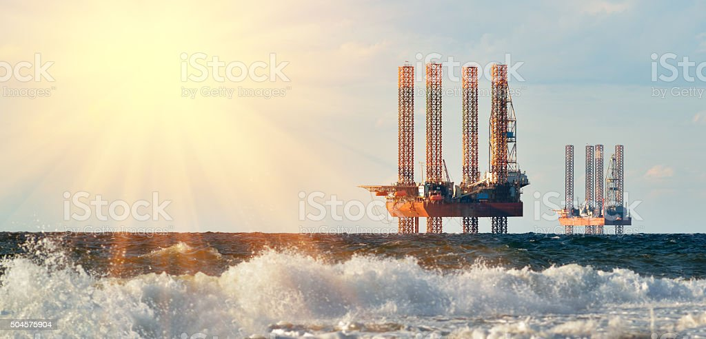 Drilling platforms on rising of the sun stock photo