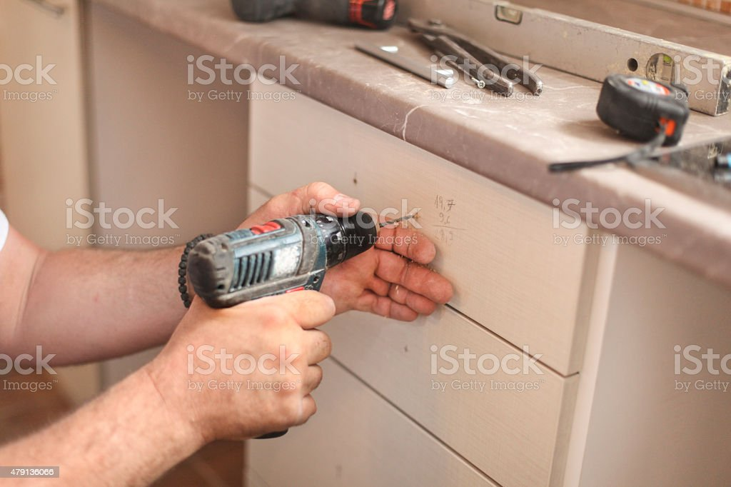 Drilling pulls for kitchen drawers stock photo