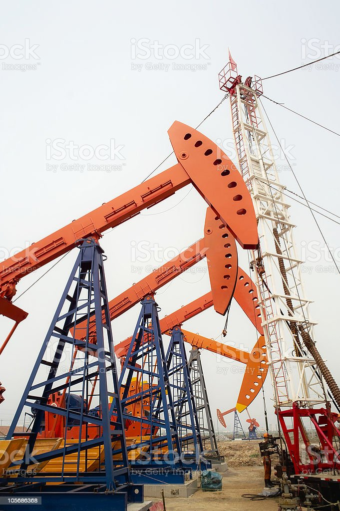 Drilling rig and  pumpjacks royalty-free stock photo