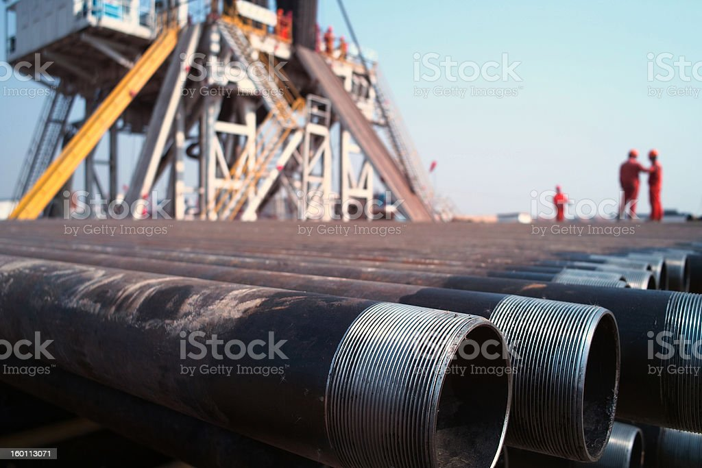 Drilling rig and worker stock photo