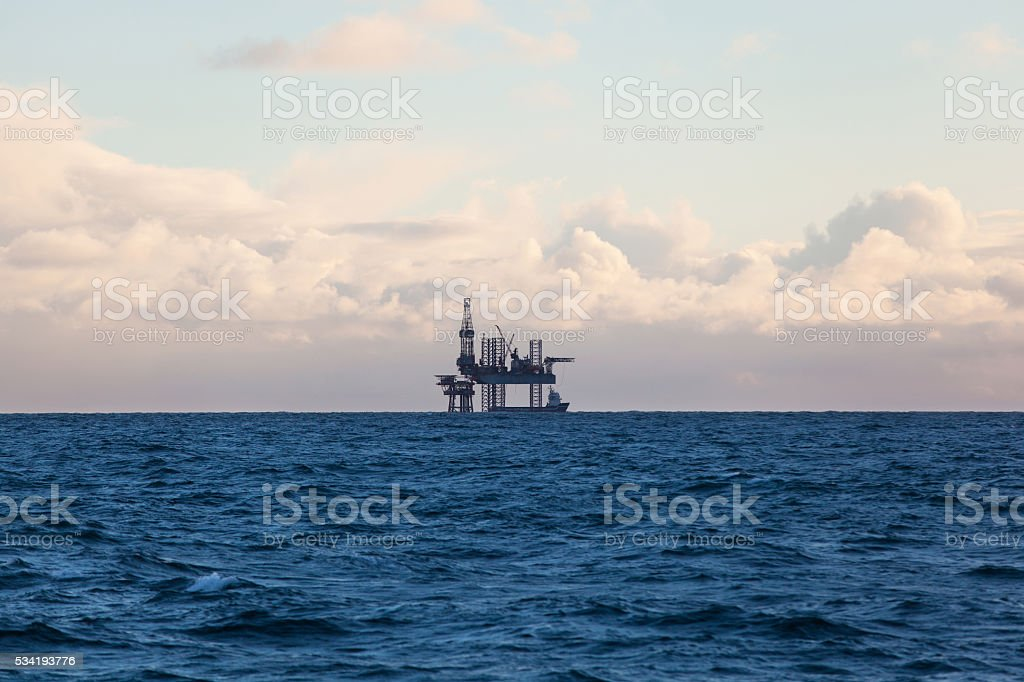 Drilling rig at sunset stock photo