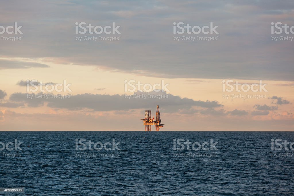 Drilling rig during sunset stock photo