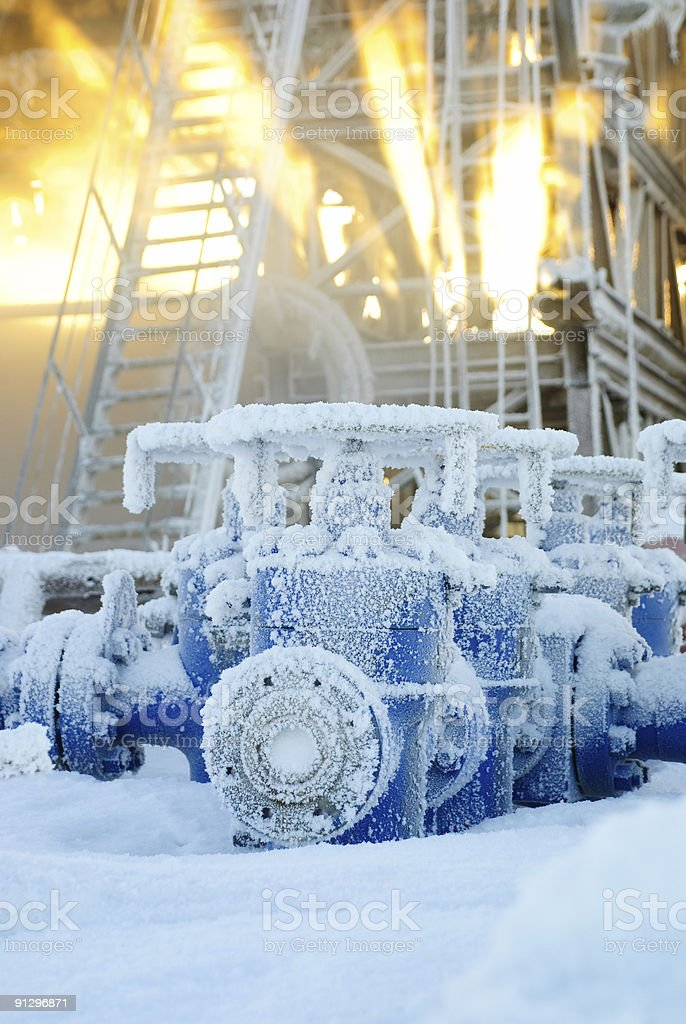 Drilling rig equipment that is covered in snow stock photo