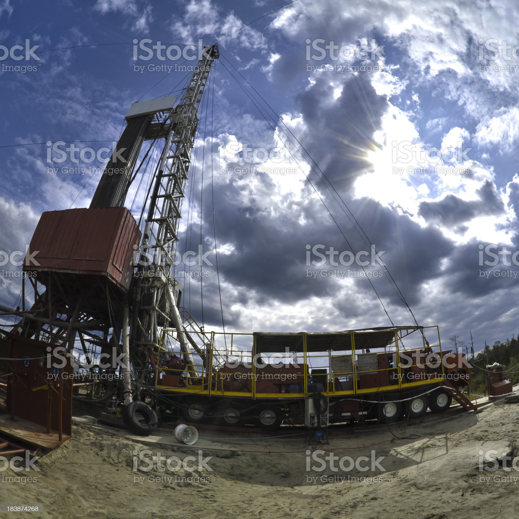 Drilling rig in front of sun royalty-free stock photo