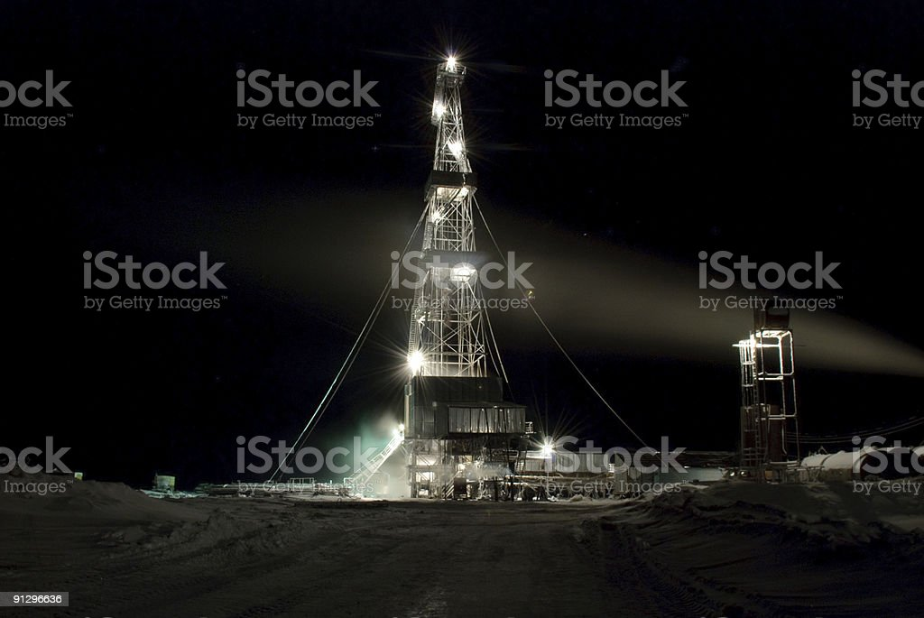 Drilling Rig in the night. Winter. stock photo