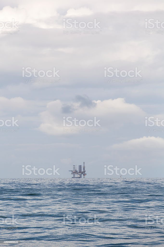 Drilling rig on cloudy day stock photo