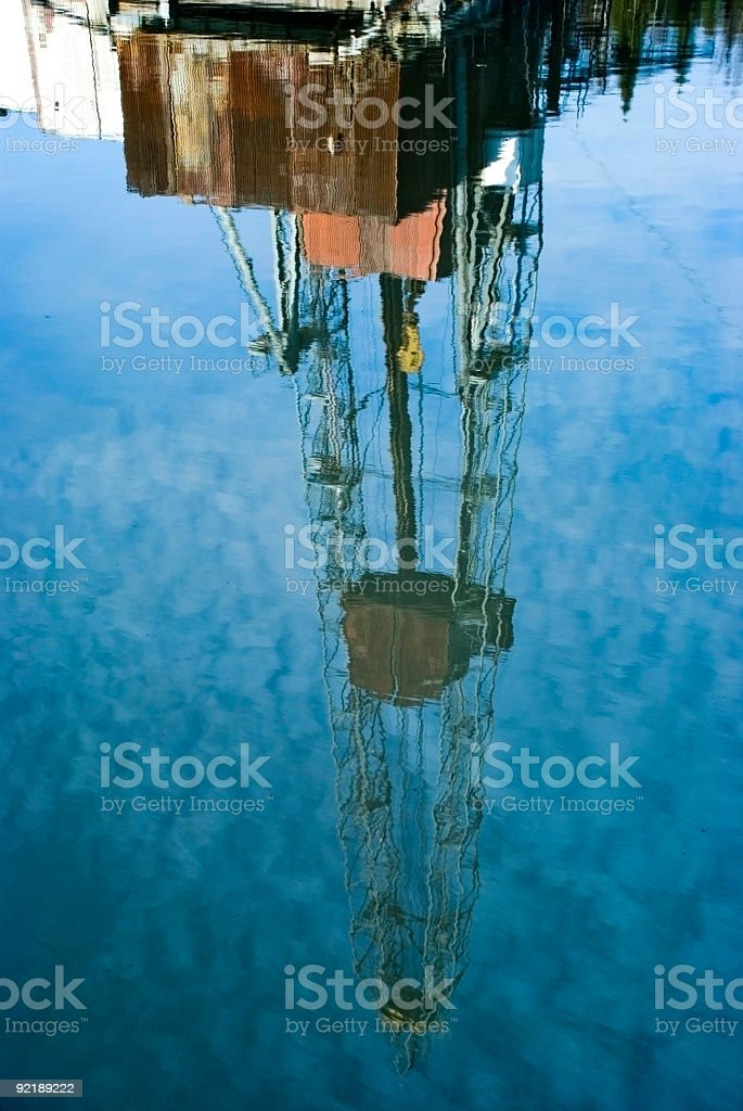 Drilling rig reflected in the water royalty-free stock photo