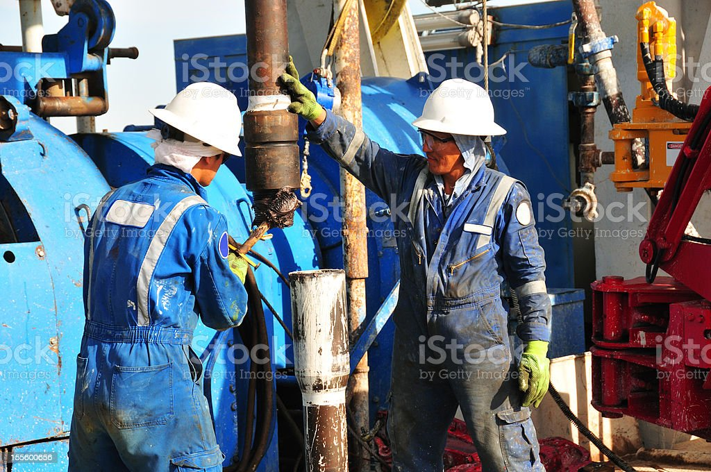Drilling rig workers royalty-free stock photo