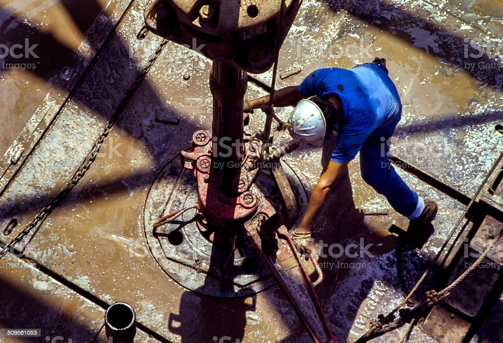 Drilling rig workers stock photo