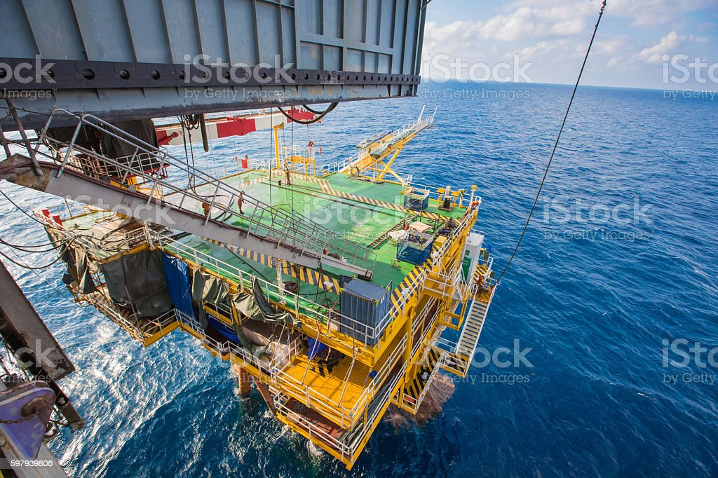 Drilling rig working on oil and gas wellhead platform stock photo