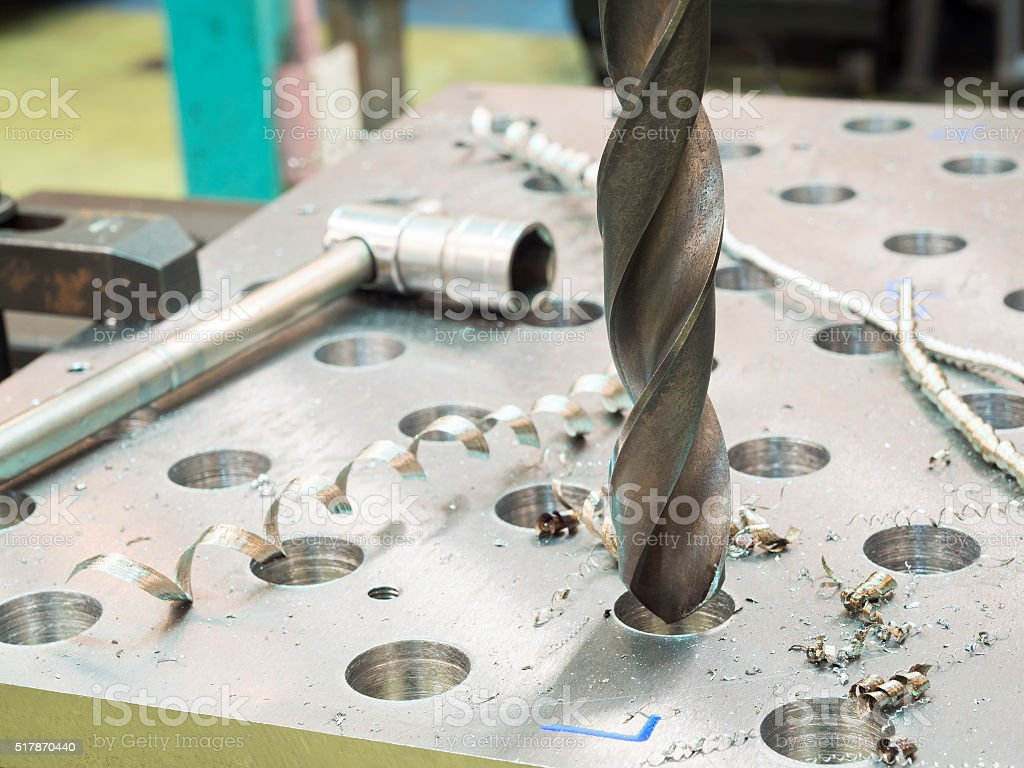 drilling steel plate stock photo