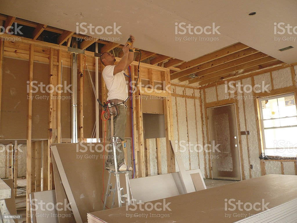 Drilling the Sheetrock stock photo