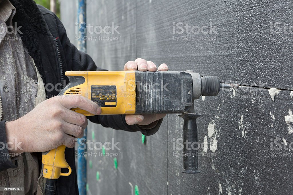 Drilling While Applying EPS on Wall stock photo