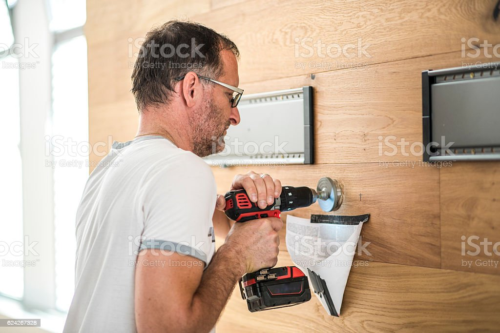 Drilling with a hole saw stock photo