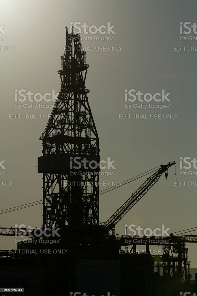 Drillship derrick and crane boom stock photo