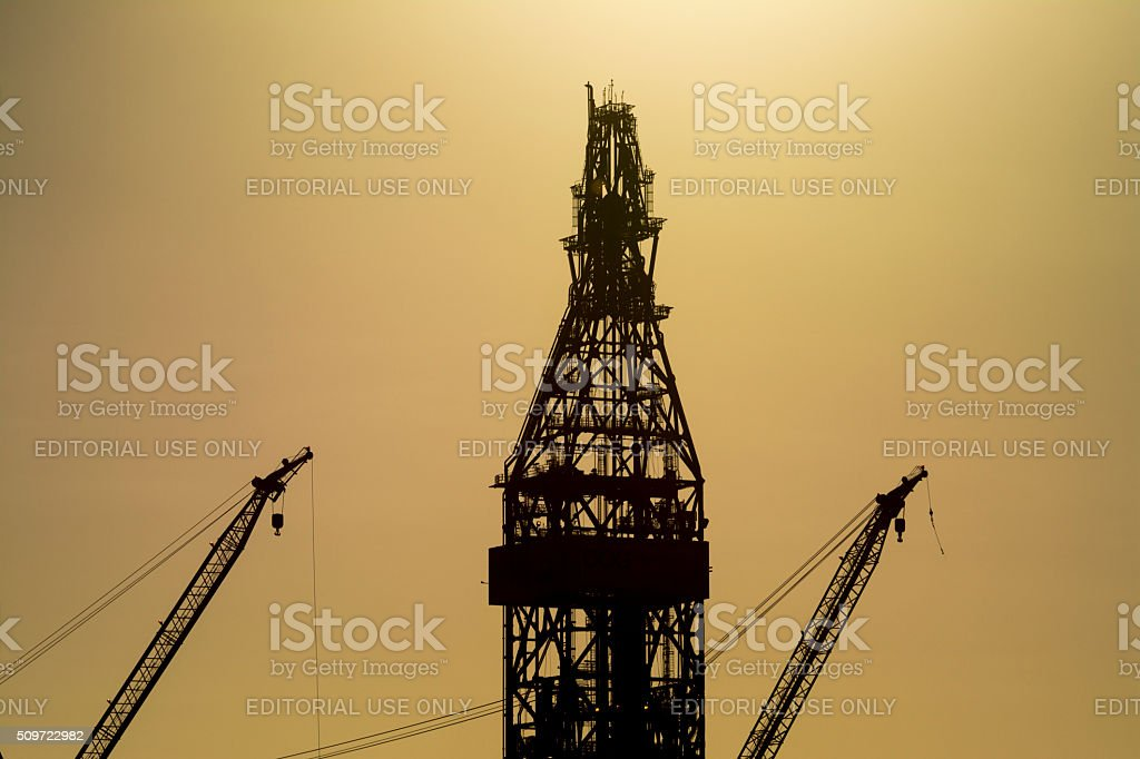 Drillship two cranes and one derrick stock photo