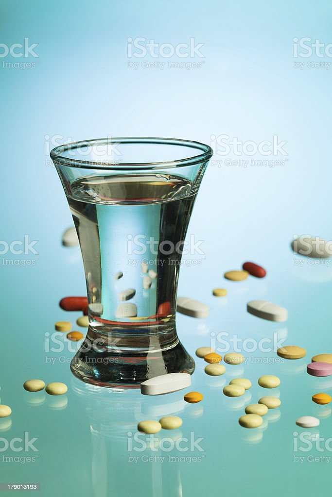 Drink and medicine pills royalty-free stock photo