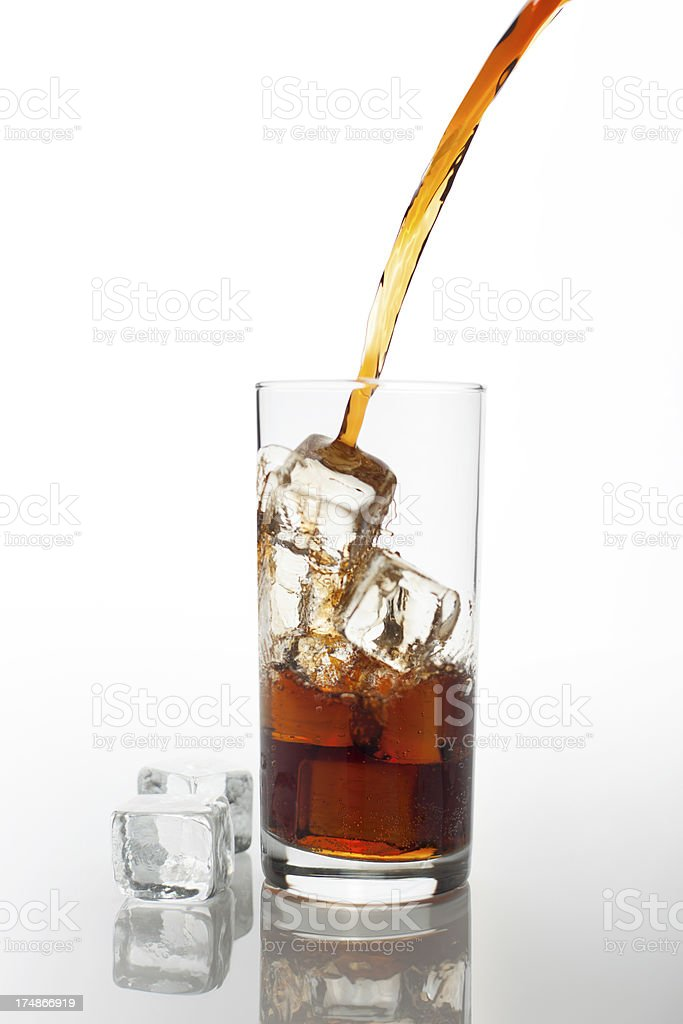 Drink being poured into a glass royalty-free stock photo