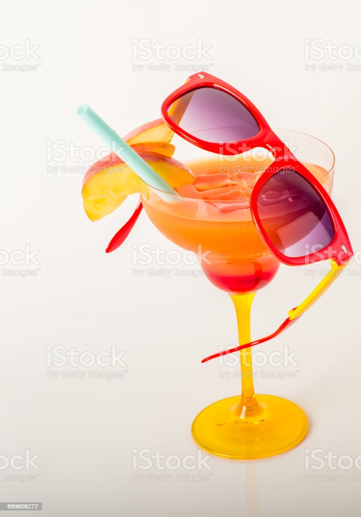 drink decorated with fruit, margarita glass, drink staw and ice cubes stock photo