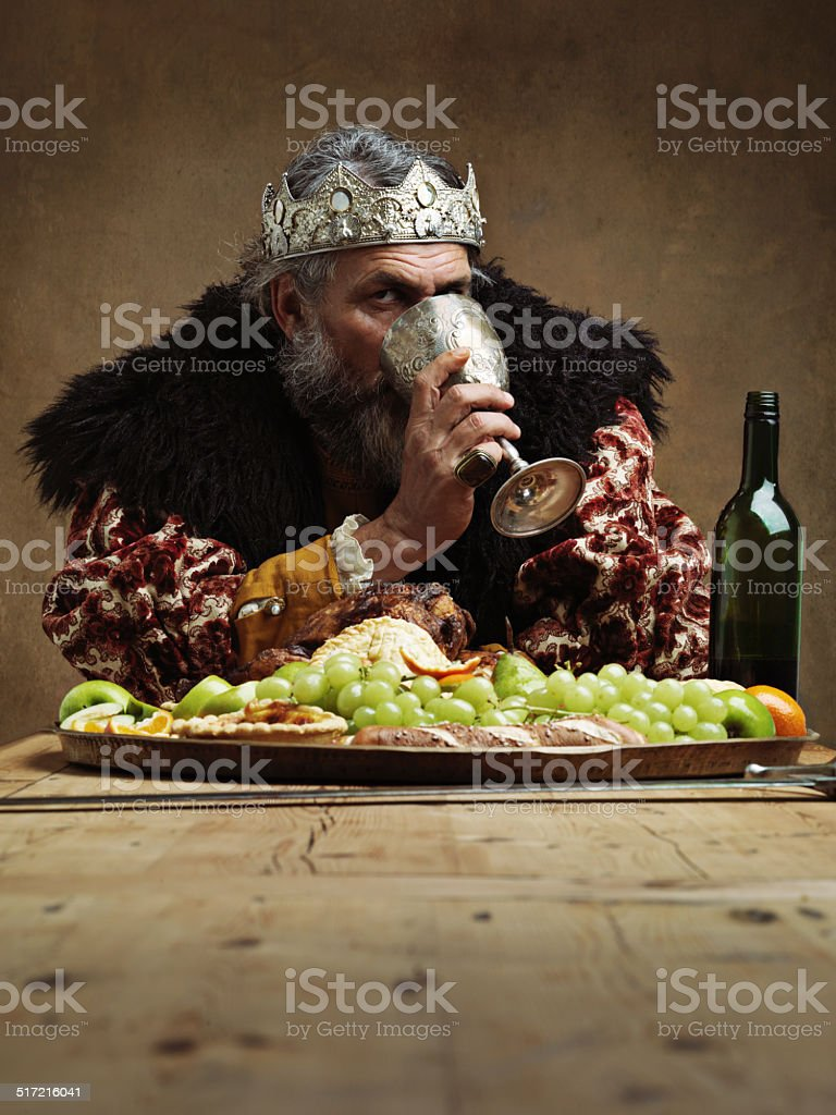 Drink deep to ease the woes of rule stock photo