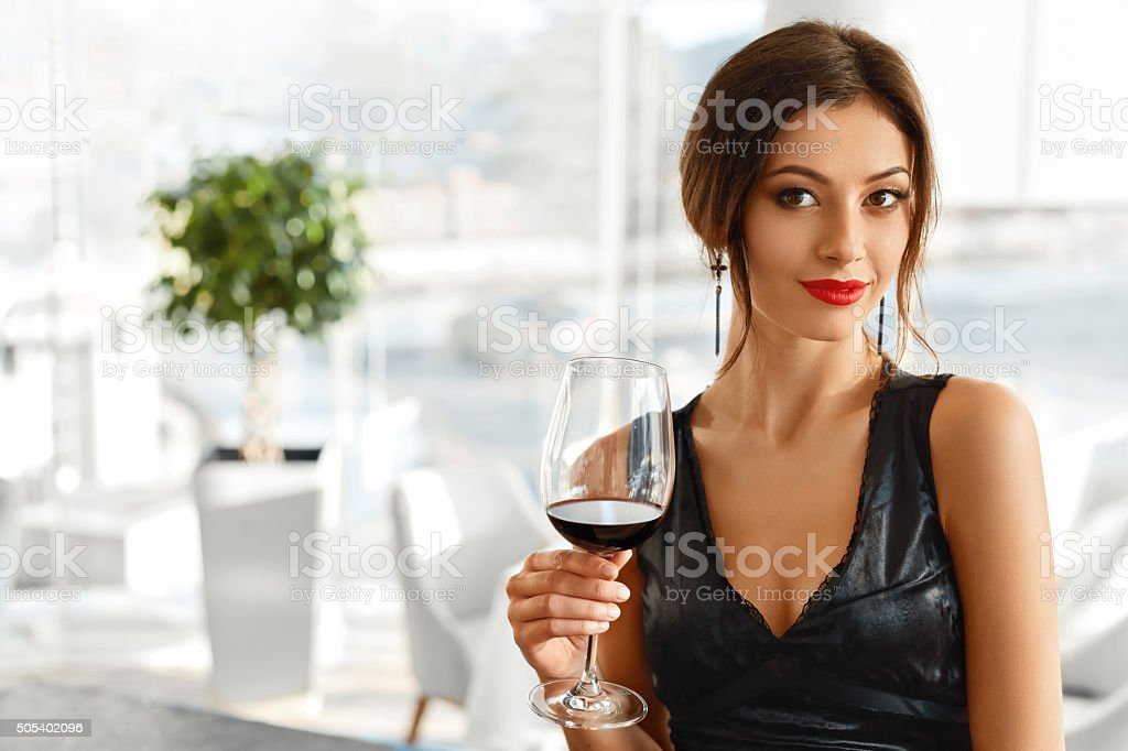 Drink. Happy Woman With Wine. Romantic Dinner In Restaurant. Celebration. stock photo