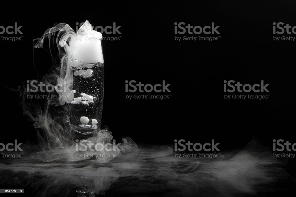 drink in glass with the effect of dry ice stock photo