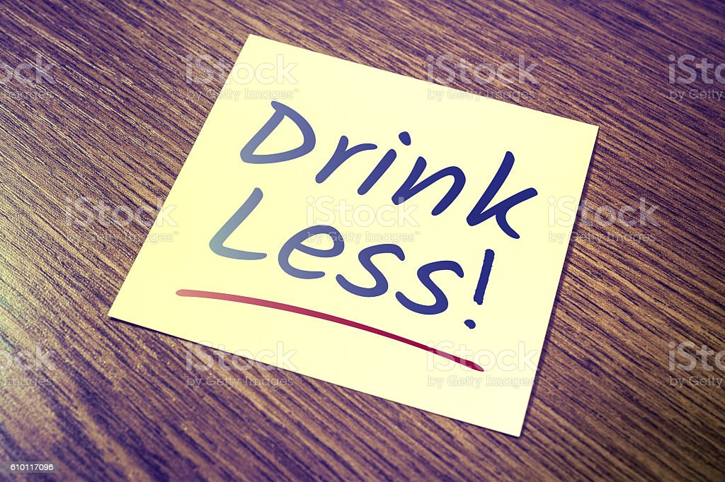 Drink Less Reminder On Paper On Wooden Cupboard stock photo