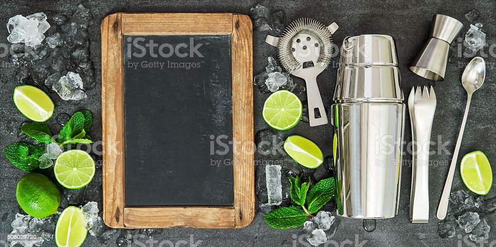 Drink making tools ingredients Lime mint blackboard stock photo