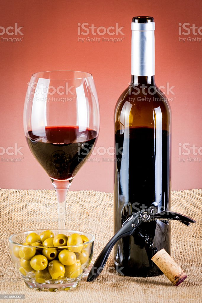 drink red wine, olives, bottle and corkscrew stock photo