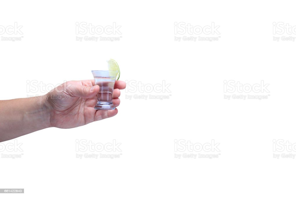 Drink responsibly!  Adult hand with shot of tequila stock photo