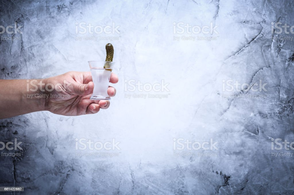 Drink responsibly!  Adult hand with shot of vodka stock photo