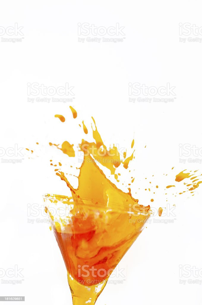 Drink splashing out of a glass royalty-free stock photo