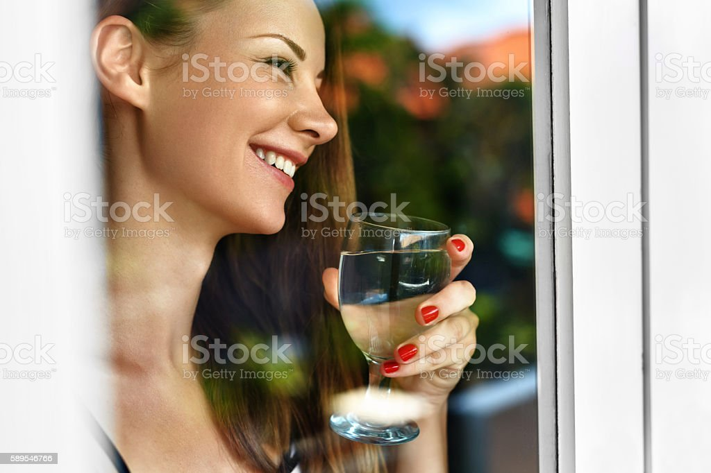 Drink Water. Smiling Woman Drinking Water. Diet. Healthy Lifestyle stock photo